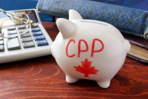 Piggy bank with word CPP. Canada Pension Plan concept.